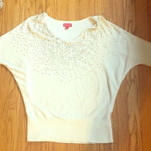 White sweater with gold sequins
